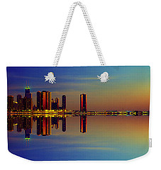 Weekender Tote Bag featuring the photograph Between Night And Day Chicago Skyline Mirrored by Tom Jelen