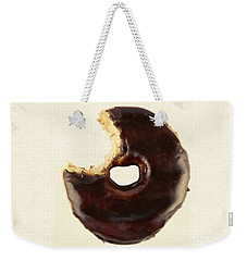 Weekender Tote Bag featuring the photograph Chocolate Donut With Missing Bite by Vizual Studio