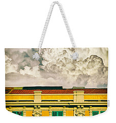 Weekender Tote Bag featuring the photograph Big Cloud Over City Building by Silvia Ganora