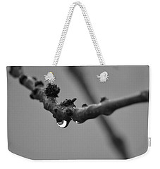 Weekender Tote Bag featuring the photograph Black And White Raindrop by Naomi Burgess