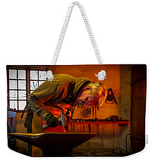 Blacksmith In Torresta Weekender Tote Bag by Torbjorn Swenelius
