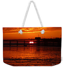 Weekender Tote Bag featuring the photograph Blazing Sunset by Vicki Spindler