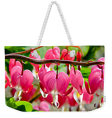 Weekender Tote Bag featuring the photograph Bleeding Heart Flowers by Kristen Fox