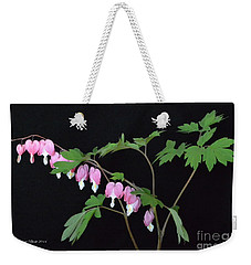 Weekender Tote Bag featuring the photograph Bleeding Hearts 2 by Jeannie Rhode
