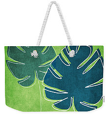 Blue And Green Palm Leaves Weekender Tote Bag by Linda Woods