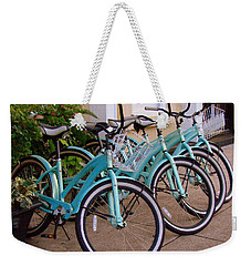 Weekender Tote Bag featuring the photograph Blue Bikes by Rodney Lee Williams