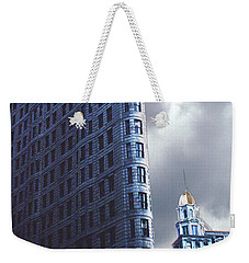 Weekender Tote Bag featuring the photograph Blue Glow Flatiron Building New York by Tom Wurl