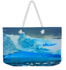 Weekender Tote Bag featuring the photograph Blue Icebergs by Amanda Stadther