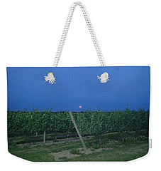 Weekender Tote Bag featuring the photograph Blue Moon by Robert Nickologianis