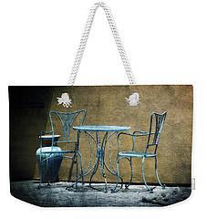Weekender Tote Bag featuring the photograph Blue Table And Chairs by Lucinda Walter