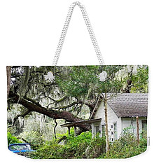 Weekender Tote Bag featuring the photograph Blue Truck And Moss by Patricia Greer