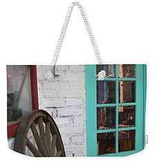 Weekender Tote Bag featuring the photograph Blue Window And Wagon Wheel by Dora Sofia Caputo Photographic Art and Design