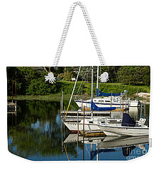 Weekender Tote Bag featuring the photograph Boat Reflections In Cape Cod Hen Cove by Eleanor Abramson