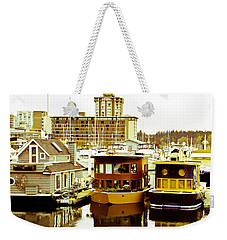 Weekender Tote Bag featuring the photograph Boathouses by Eti Reid