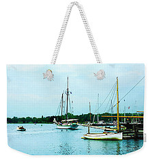 Weekender Tote Bag featuring the photograph Boats On A Calm Sea by Susan Savad