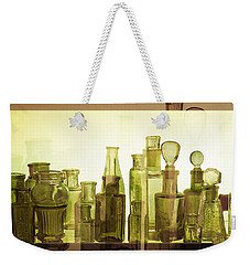 Weekender Tote Bag featuring the photograph Bottled Light by Holly Kempe