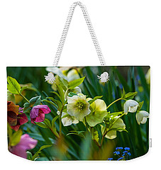 Weekender Tote Bag featuring the photograph Bouquet Of Lenten Roses by Jordan Blackstone