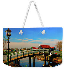 Weekender Tote Bag featuring the photograph Bridge Over Calm Waters by Jonah  Anderson