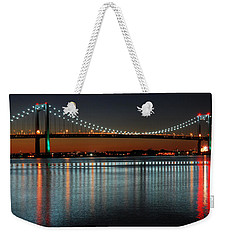 Weekender Tote Bag featuring the photograph Suspended Reflections by James Kirkikis