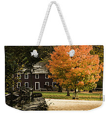 Weekender Tote Bag featuring the photograph Bright Orange Autumn by Jeff Folger