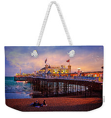 Weekender Tote Bag featuring the photograph Brighton's Palace Pier At Dusk by Chris Lord