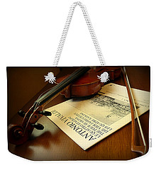 Weekender Tote Bag featuring the photograph Broken String by Lucinda Walter