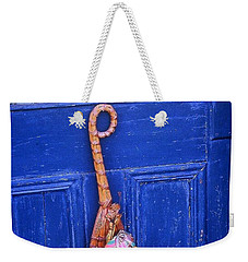 Weekender Tote Bag featuring the photograph Broom On Blue Door by Rodney Lee Williams