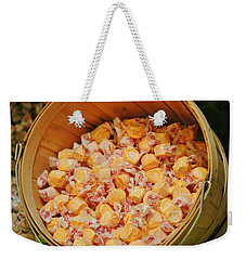 Weekender Tote Bag featuring the photograph Bucket Of Taffy by Cynthia Guinn