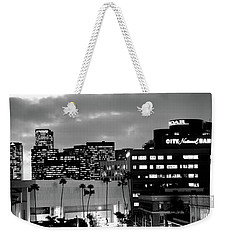 Building Lit Up At Night In A City Weekender Tote Bag by Panoramic Images