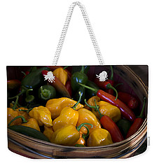 Weekender Tote Bag featuring the photograph Bushel Of Peppers by Julie Palencia