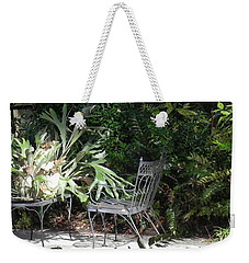 Weekender Tote Bag featuring the photograph Bust In A Garden With Staghorn Fern by Patricia Greer