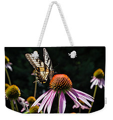 Weekender Tote Bag featuring the photograph Butterfly In The Garden by Glenn DiPaola