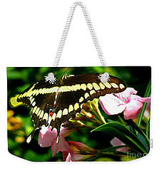 Weekender Tote Bag featuring the photograph Butterfly by Kristine Merc