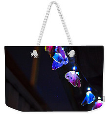 Weekender Tote Bag featuring the photograph Butterfly Lights Hanging At Night  by Naomi Burgess