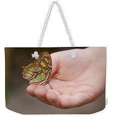 Weekender Tote Bag featuring the photograph Butterfly On Hand by Leticia Latocki
