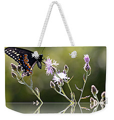 Weekender Tote Bag featuring the photograph Butterfly With Reflection by Eleanor Abramson