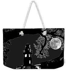 Weekender Tote Bag featuring the photograph By The Light by Robert McCubbin