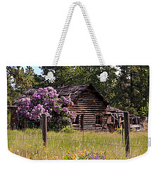 Weekender Tote Bag featuring the photograph Cabin And Wildflowers by Athena Mckinzie