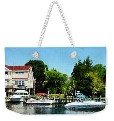 Weekender Tote Bag featuring the photograph Cabin Cruisers by Susan Savad