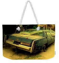 Weekender Tote Bag featuring the photograph Cadillac Wreck by Salman Ravish