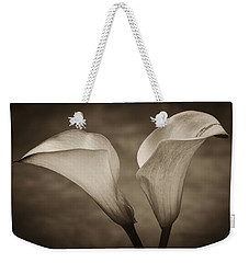 Weekender Tote Bag featuring the photograph Calla Lilies In Sepia by Sebastian Musial
