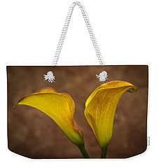 Weekender Tote Bag featuring the photograph Calla Lilies by Sebastian Musial
