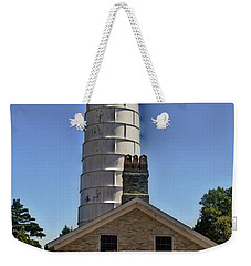 Weekender Tote Bag featuring the photograph Cana Island Lighthouse by Deborah Klubertanz