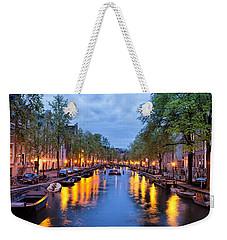 Canal In Amsterdam At Dusk Weekender Tote Bag
