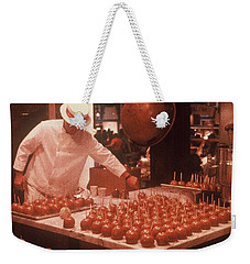 Weekender Tote Bag featuring the photograph Candy Apple Man by Rodney Lee Williams