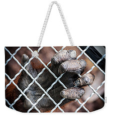 Weekender Tote Bag featuring the photograph Captive Heart by Sennie Pierson