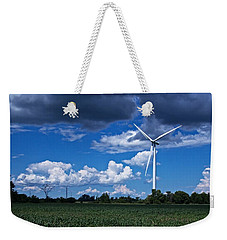 Weekender Tote Bag featuring the photograph Capture The Wind by Dave Files