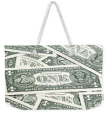 Weekender Tote Bag featuring the photograph Carpet Of One Dollar Bills by Lee Avison
