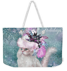Weekender Tote Bag featuring the mixed media Cat In The Snowflake Santa Hat by Carol Cavalaris