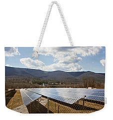 Weekender Tote Bag featuring the photograph Catching Rays  by Carol Lynn Coronios